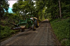 A tractor hauling hay moves slowly down Western Loudoun's historic dirt road known as Paxson Road outside of the Village of Airmont. (Photo by Douglas Graham/WLP)