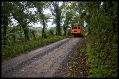 A school bus makes its way along Western Loudoun's historic gravel road known as Poor House Road. Many of the gravel roads in Loudoun are important heritage resources that represent the migration, settlement and travel patterns of the County's early populations. Historic travel routes are also essential components of the County's historic landscape as it associates with standing structures, linking early settlements. (Photo by Douglas Graham/WLP)
