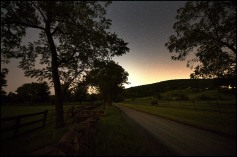 A star light sky over Western Loudoun's historic dirt road known as Ridgeside Road outside of the Village of Bluemont. Many of the dirt roads in Loudoun are important heritage resources that represent the migration, settlement and travel patterns of the County's early populations. Historic travel routes are also essential components of the County's historic landscape as it associates with standing structures, linking early settlements. (Photo by Douglas Graham/WLP)
