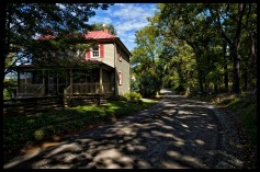 Rodeffer Road in Northern Loudoun County near the village of Waterford. Many of the dirt roads in Loudoun are important heritage resources that represent the migration, settlement and travel patterns of the County's early populations. Historic travel routes are also essential components of the County's historic landscape as it associates with standing structures, linking early settlements. (Photo by Douglas Graham/WLP)