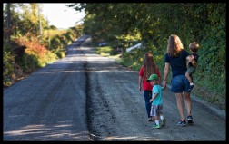 """Work has started for the paving of Williams Gap road in Western Loudoun that will forever change the character of this historic road. Laura Anthony takes a walk with her children Mandy, Brady, Alli, Shane and R.J. over the road bed that George Washington and Load Fairfax rode their horses on to survey land in the Shenandoah Valley. An hour after this photo was taken the road was completely covered making the Anthony's the last people to walk over the original road. Today, most residents of Loudoun County know nothing about Williams Gap, even those living on Williams Gap Road (Route 711). Knowing who """"Williams"""" was, why a gap in the Blue Ridge Mountains was named for him, and why the rural character of historic Williams Gap Road should be preserved are all significant to our heritage, particularly to those living in Western Loudoun. (photo by Douglas Graham/WLP)"""